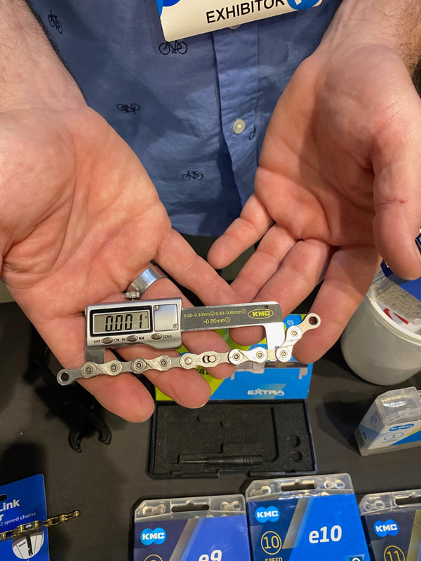 KMC digital chain checker bike tool in a person's hands